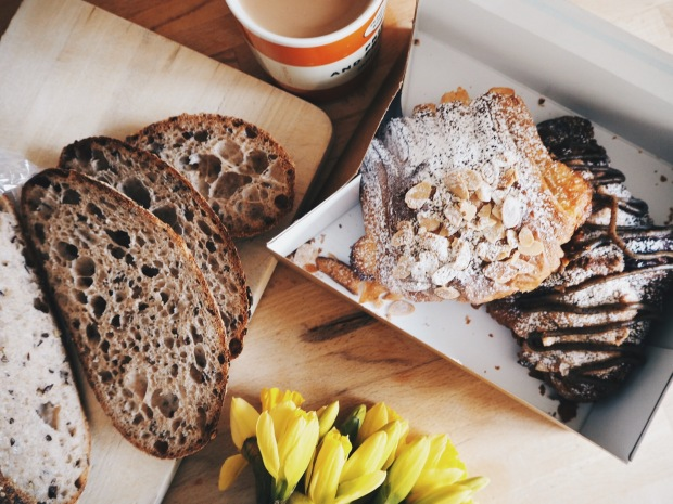 Pastry and freshly baked bread from The Hoxton Bakehouse, with tea and daffodils