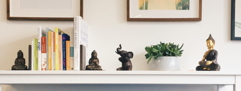 Yoga studio office; shelf with ornaments, posters and yoga towels