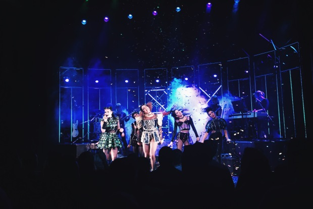 The cast of Six perform on stage with glittering pop-star outfits