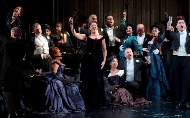 WNO La traviata - Rebecca Afonwy-Jones (Flora), Linda Richardson (Violetta), Kang Wang (Alfredo) and WNO Chorus. Photo credit Betina Skovbro - 2941a copy