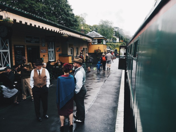 a rainy vintage train station