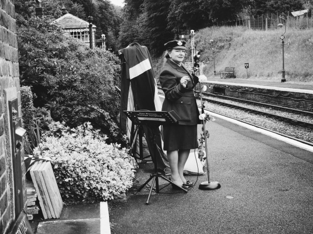 A vintage singer at a station, in uniform