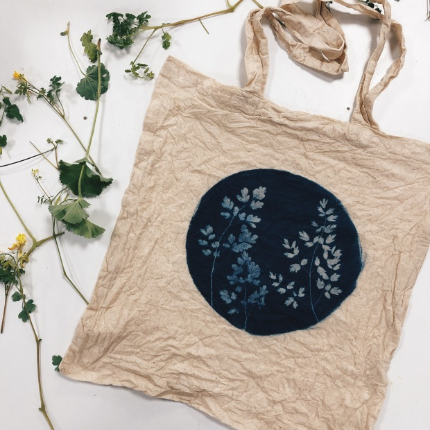 a tote bag dyed with cyanotype print