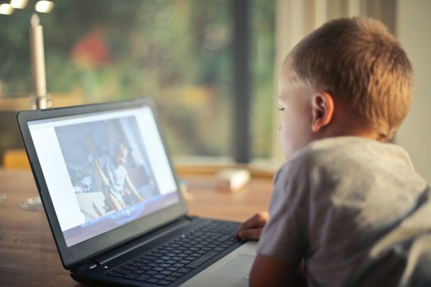 Boy video calling on a laptop