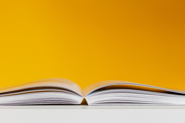 white-book-in-white-table-near-yellow-wall-3760323