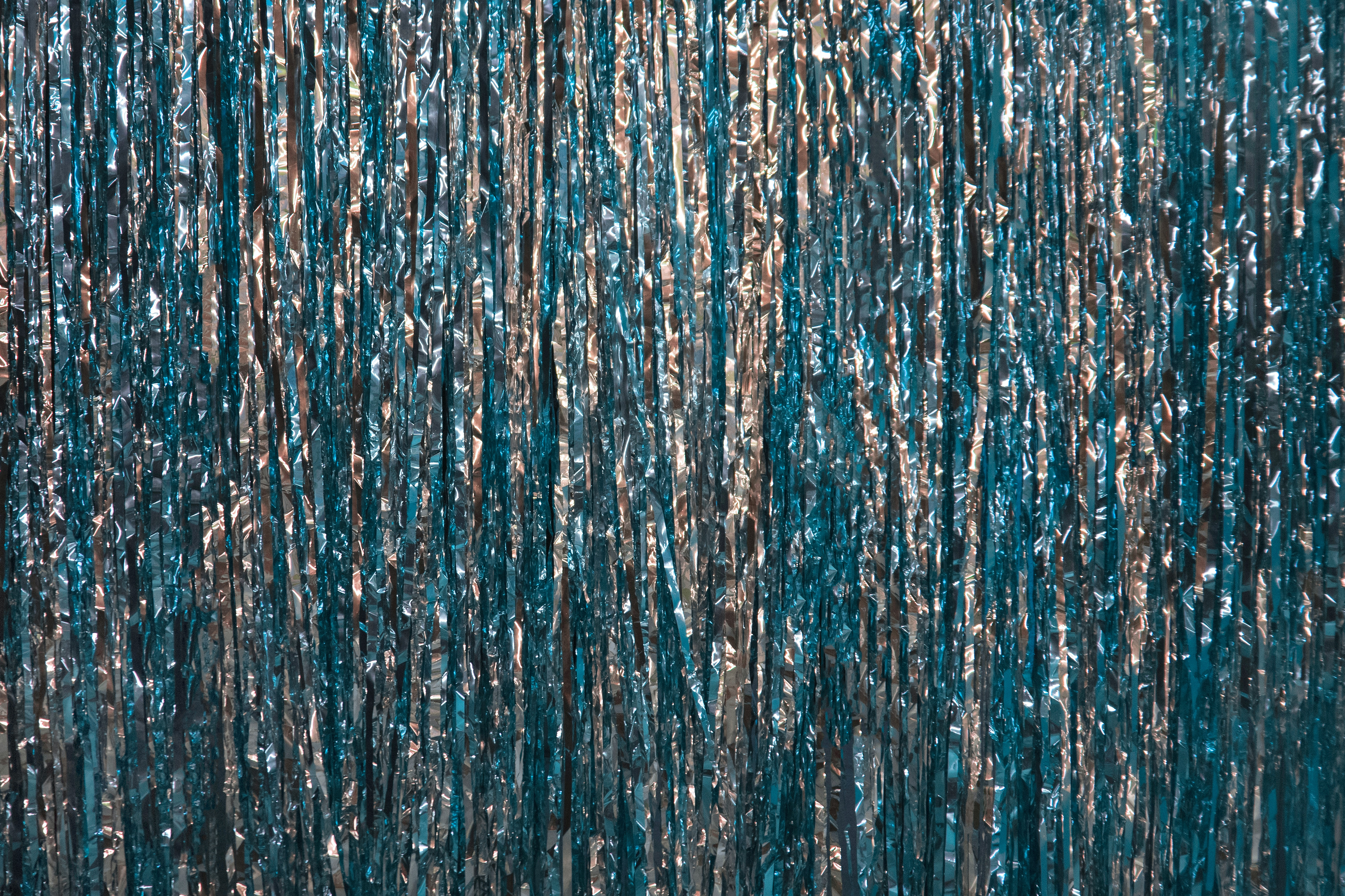 Blue and silver metallic streamers up close